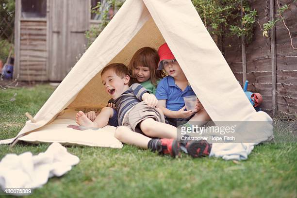 Young friends in a garden camp