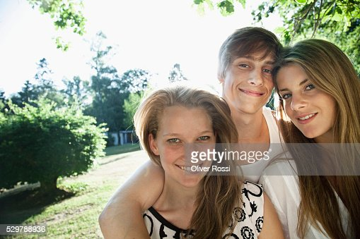 Young friends in a park : Stock Photo