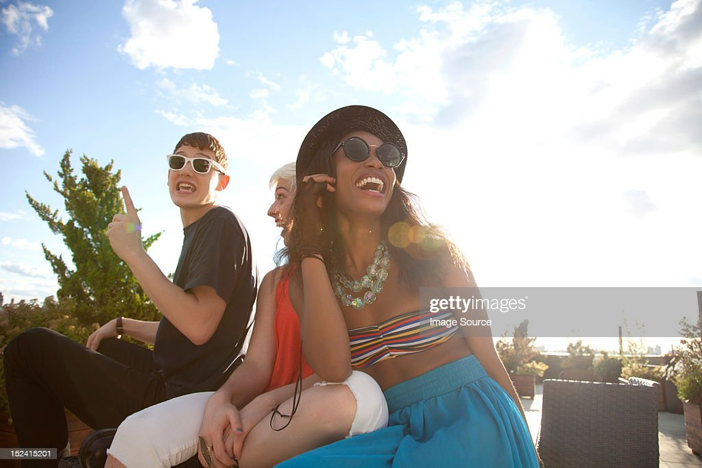 Young friends laughing : Stock Photo