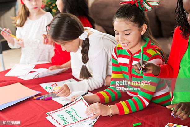 Young friends make homemade Christmas cards together