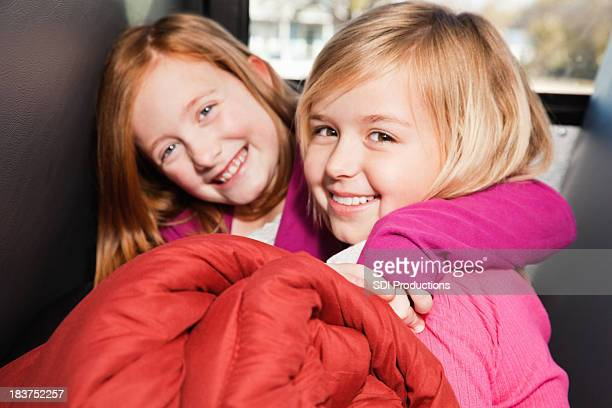 Young Friends on Bus With Sleeping Bag Going to Camp