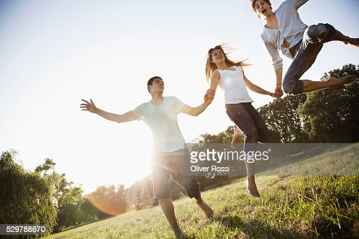 Young friends playing in a park : Stockfoto