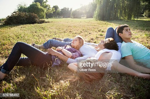 Young friends relaxing in a park : Stock Photo