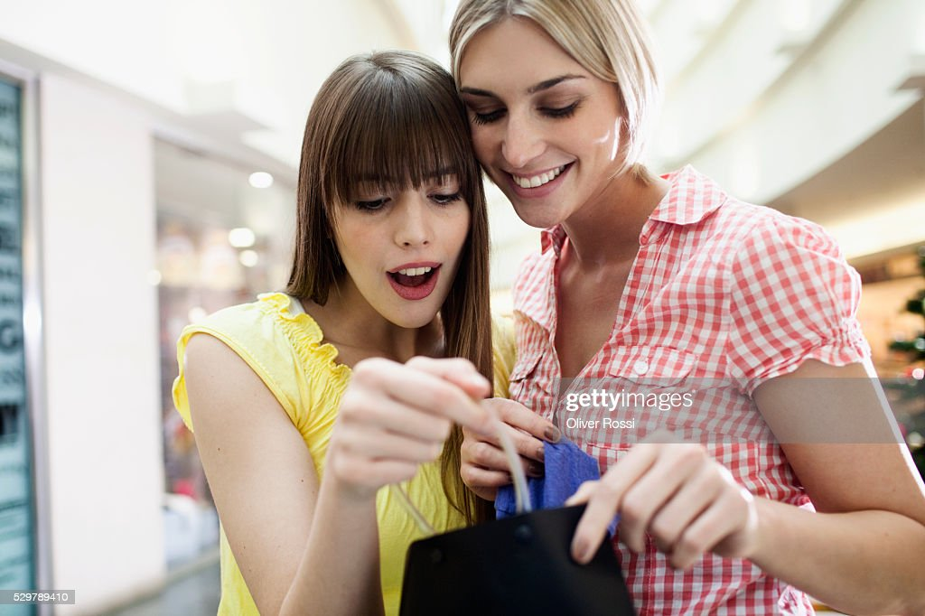 Young friends shopping : Stock Photo