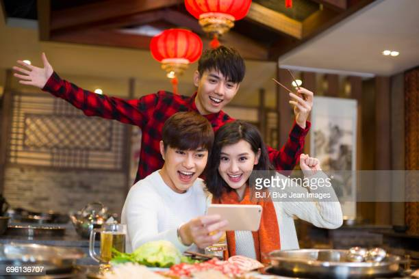 Young friends taking self portrait with a smart phone