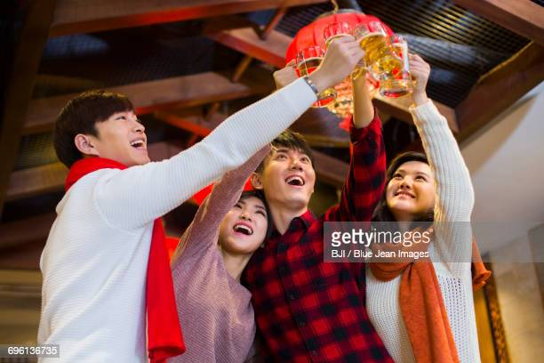 Young friends toasting for Chinese new year