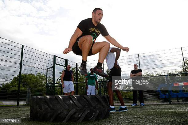 Young Fury jumps over a tractor tyre during the Tyson Fury Media Session at the Eddie Davies Football Academy on June 17 2014 in Bolton England