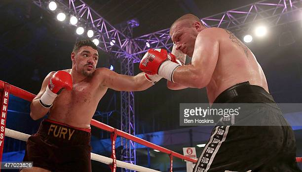 Young Fury of Great Britain and Jindrich Velecky of Czech Republic exchange blows during their Heavyweight bout at Action Indoor Sports Arena on June...