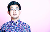 Young Geeky  Man in colorful shirt wearing glasses