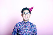 Young Geeky  Man wearing party hat