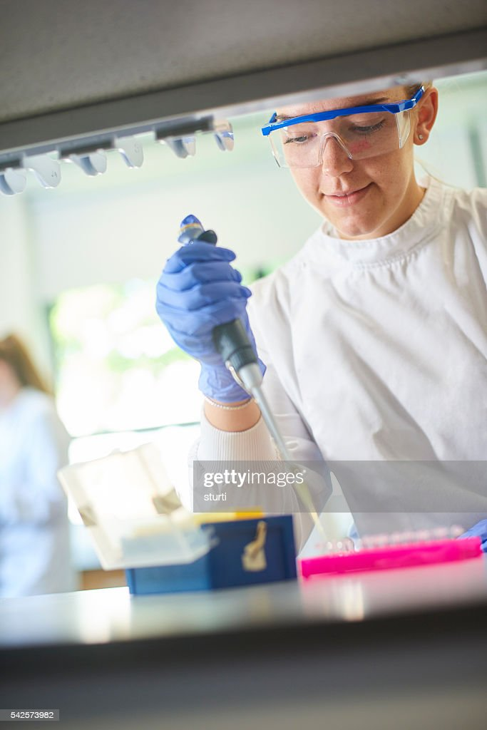 young genetics scientist with pipette