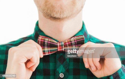 Young gentleman correcting bow : Stock Photo