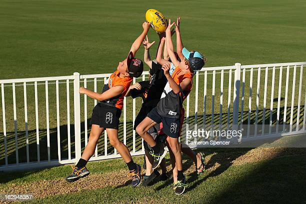 Young Giants fans in the crowd mark the ball during the round two AFL NAB Cup match between the Greater Western Sydney Giants and the Brisbane Lions...