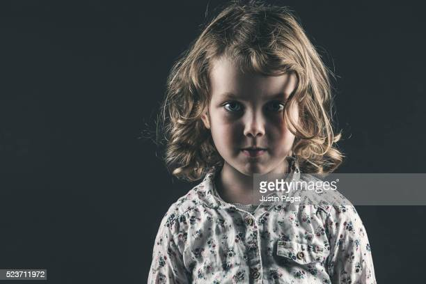 Young Girl against Dark Background