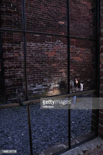Young Girl Alone in Dark Brick Alley