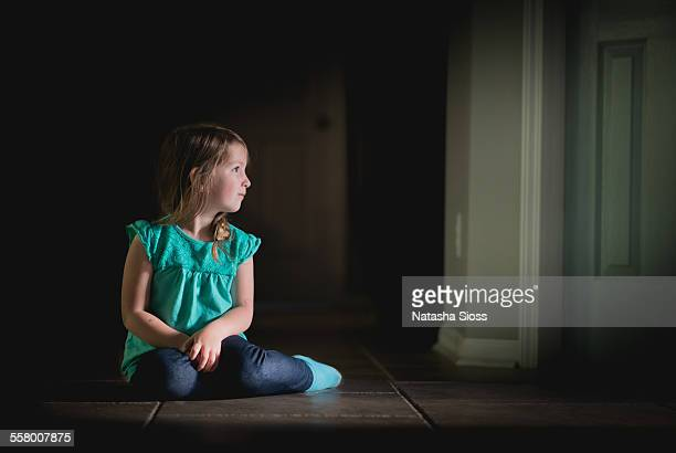 Young girl alone in the dark