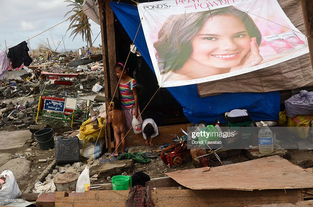 A young girl and a boy stay in a makeshift hut near the shoreline following the recent super typhoon on November 21, 2013 in Tacloban, Leyte, Philippines. Typhoon Haiyan, which ripped through the Philippines on November 9, has been described as one of the most powerful typhoons ever to hit land, leaving thousands dead and hundreds of thousands homeless. Countries all over the world have pledged relief aid to help support those affected by the typhoon, however damage to the airport and roads have made moving the aid into the most affected areas very difficult. With dead bodies left out in the open air and very limited food, water and shelter, health concerns are growing.