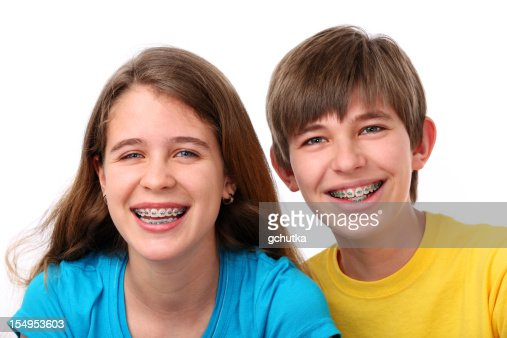 Young Girl And Boy With Braces