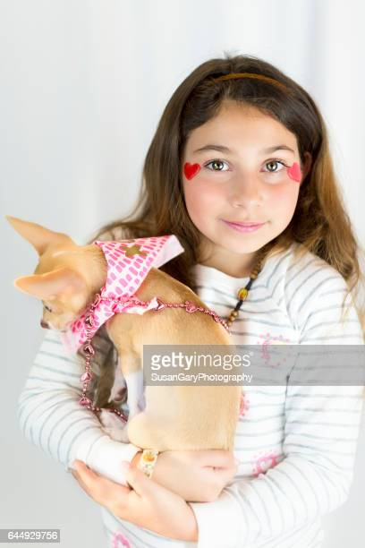 Young Girl and Chihuahua Puppy