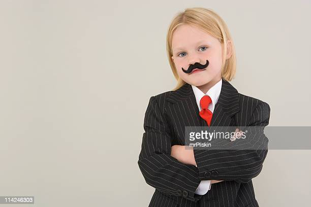 Young girl and false moustache