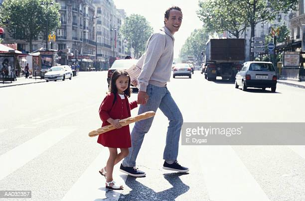 Young Girl and Her Father Crossing the Street