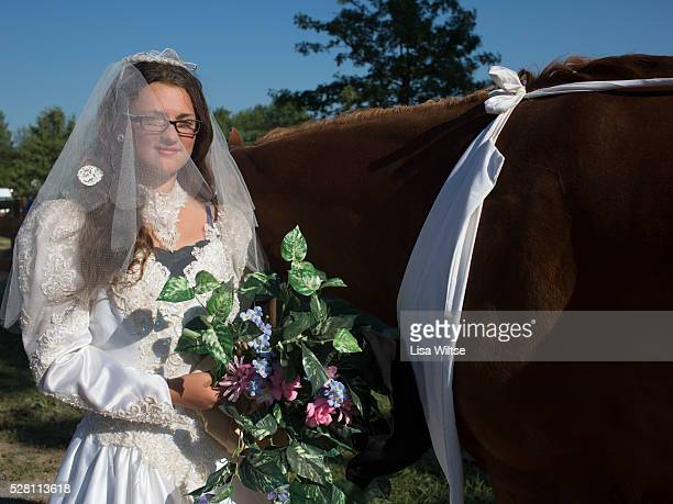 A young girl and her horse dressed in a wedding gown at the Medina County Fair in Medina Ohio on August 1 2012 Photo by Lisa Wiltse