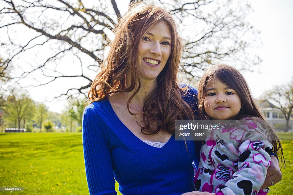 A young girl and her mother having fun together. : Stock Photo