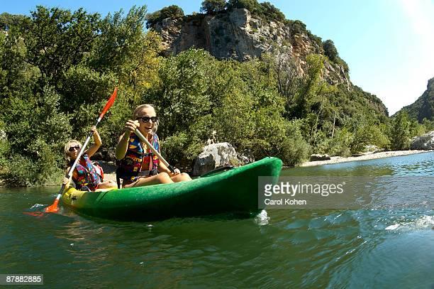 Young girl and mother doing kayak