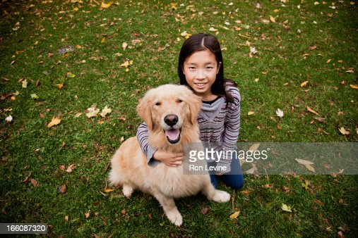 Young girl and pet golden retriever, portrait : Stock Photo