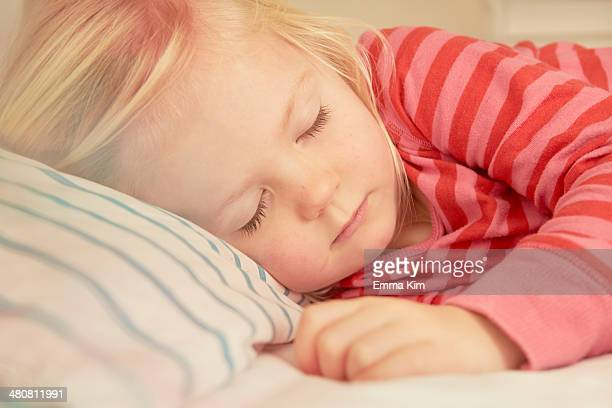 Young girl asleep in bed