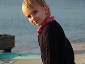 Young girl at beach looking at camera