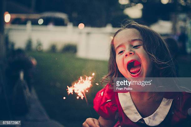 Young girl at dusk with a sparkler