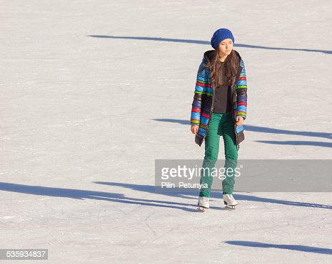 Young girl at the ice rink outdoor : Stock Photo