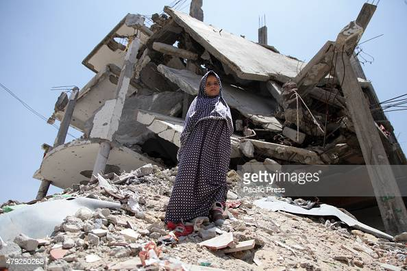 A young girl at the rubble of their house damaged during the 2014 IsraelGaza conflict at Al Shejaeiya neighborhood in the east of Gaza