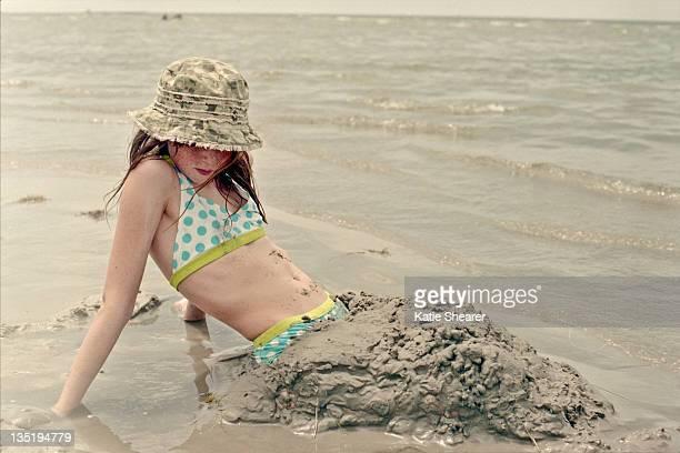 Young girl bikini in sand on beach