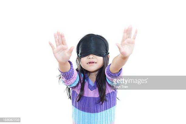 Young girl blindfolded