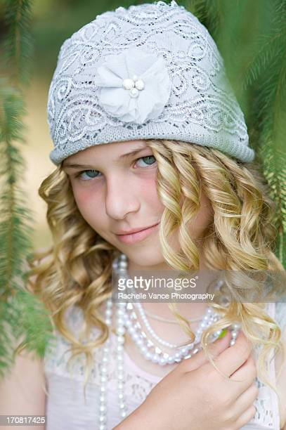 young girl, blonde, with hat