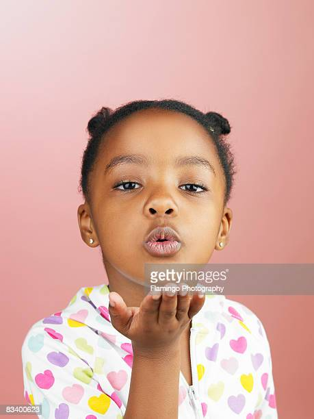 Young girl blowing kiss to camera