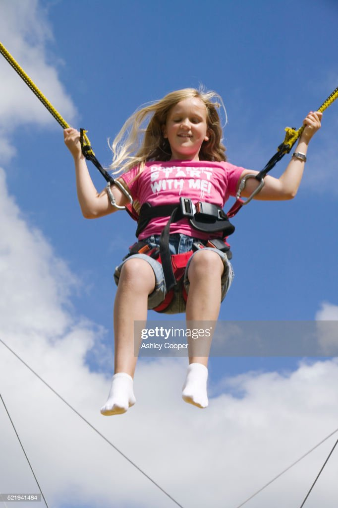 Young Girl Bouncing in Bungee Harness