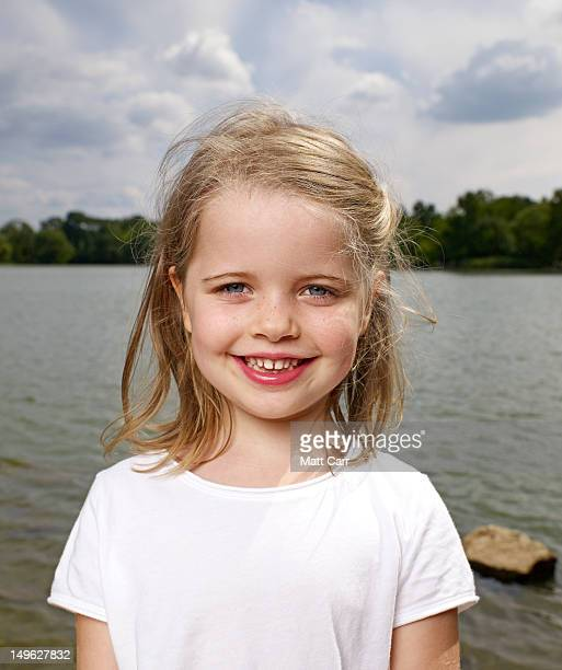 Young girl by lake