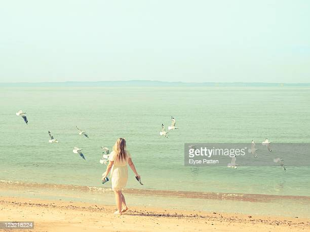 Young girl by sea