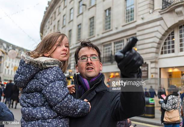Young Girl Carried By Her Father At Winter Christmas Markets