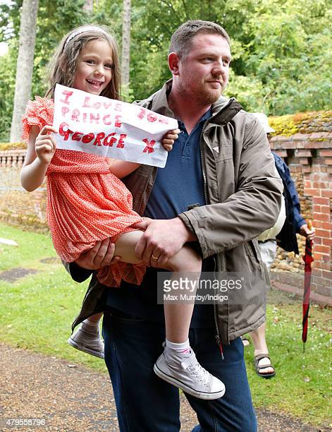 A young girl carries an 'I love you Prince George' sign as she queues outside the church of St Mary Magdalene on the Sandringham Estate prior to the...