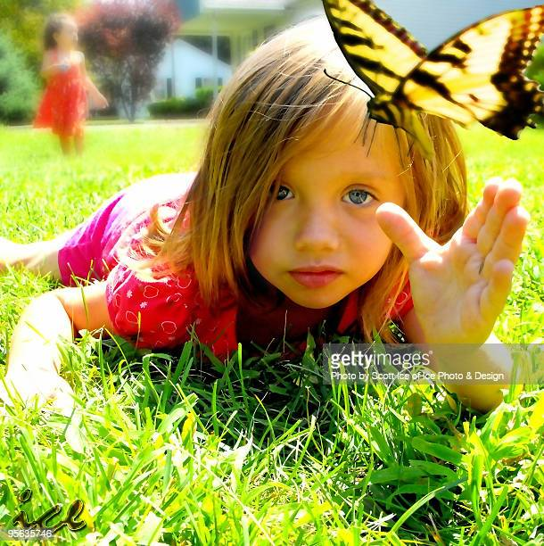 Young Girl Catching a Butterfly