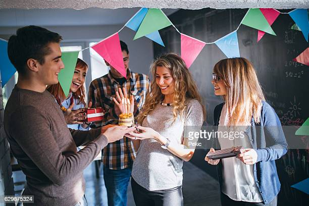 Young girl celebrating her 27st birthday with friends