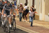 A young girl chases the peloton along the 2275km route from Montargis to Gueugnon in stage six of the Tour de France July 9 2010 in Gueugnon France...