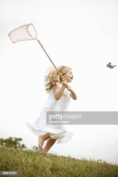 Young Girl Chasing Butterflies