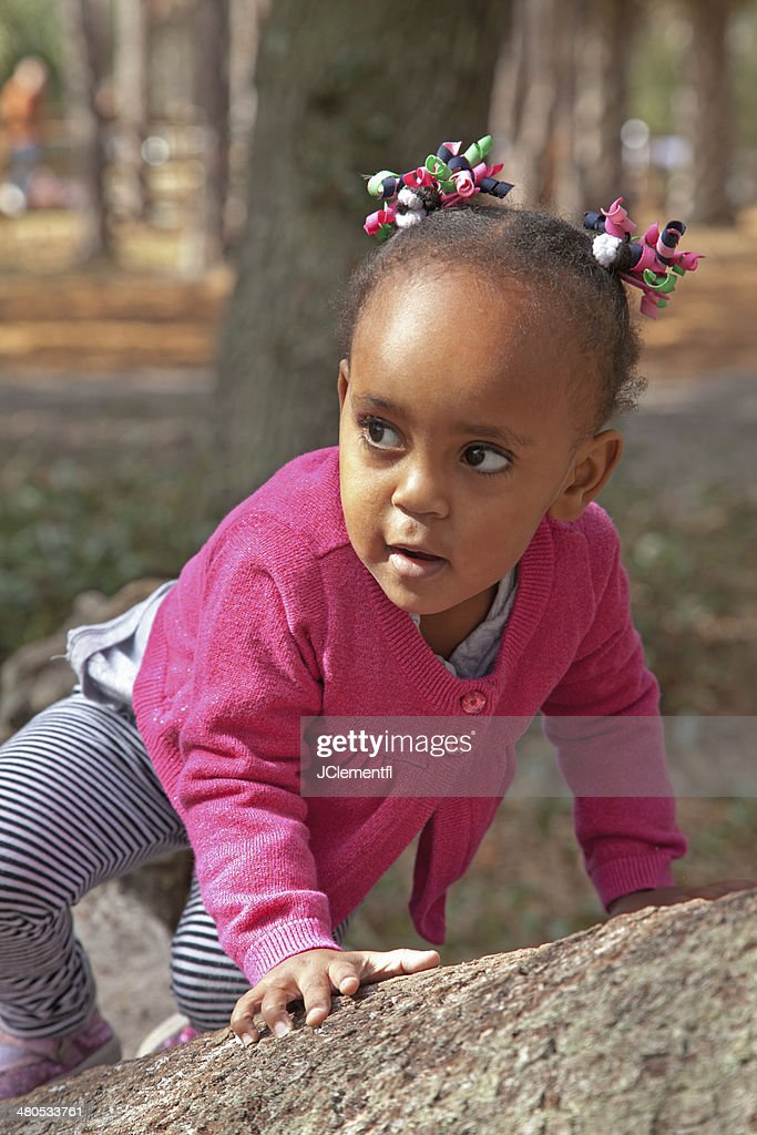 Young Girl Climbs on Tree : Stock Photo