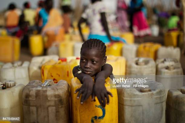 A young girl collects fres water near Doro refugee camp in BunjMaban in the Upper Nile Blue Nile state of northeastern South Sudan AfricaThe region...