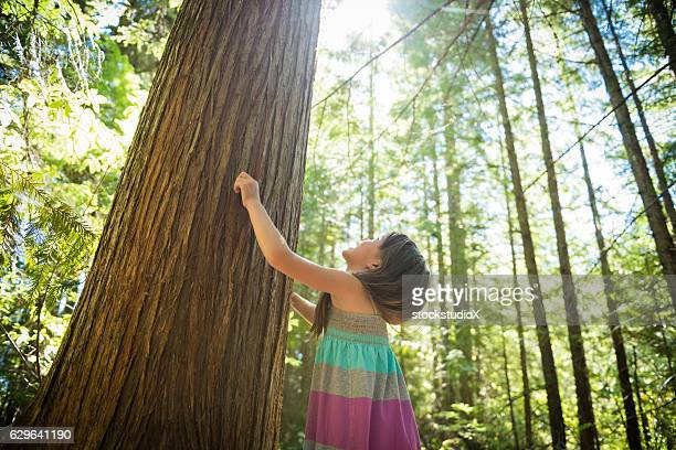 Young girl connecting with nature
